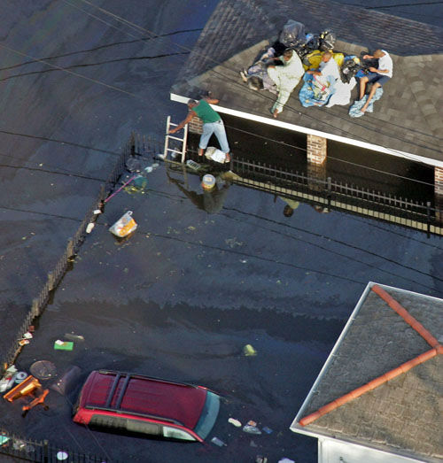 "<div class=""meta image-caption""><div class=""origin-logo origin-image none""><span>none</span></div><span class=""caption-text"">Residents wait atop a roof as floodwaters from Hurricane Katrina fill the streets of New Orleans Tuesday, Aug. 30, 2005. (Photo/DAVID J. PHILLIP)</span></div>"