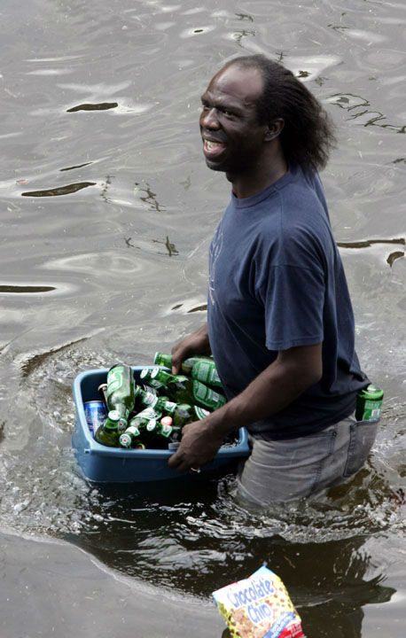 "<div class=""meta image-caption""><div class=""origin-logo origin-image none""><span>none</span></div><span class=""caption-text"">A looter carries a bucket of beer out of a grocery store in New Orleans on Tuesday, Aug. 30, 2005, as floodwaters continue to rise in New Orleans. (AP Photo/ DAVE MARTIN)</span></div>"