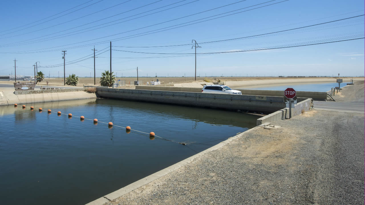 This July 23, 2015 photo of the Russell Avenue Bridge in Firebaugh, Calif. shows the drought has caused the bridge to sink.