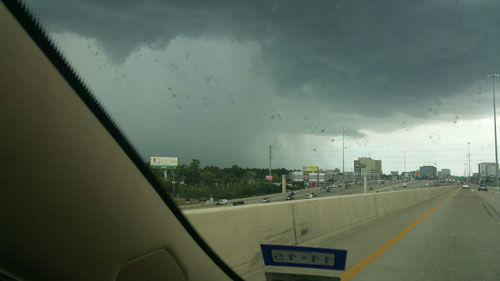"<div class=""meta image-caption""><div class=""origin-logo origin-image none""><span>none</span></div><span class=""caption-text"">Dark clouds and rain near the Katy Freeway at Wilcrest (Photo/iWitness Photo)</span></div>"