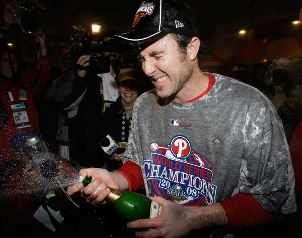"""<div class=""""meta image-caption""""><div class=""""origin-logo origin-image none""""><span>none</span></div><span class=""""caption-text"""">Chase Utley sprays champagne in the team's locker room after their victory in Game 5 of the baseball World Series in Philadelphia, Wednesday, Oct. 29, 2008. (AP Photo/ Chris O'Meara)</span></div>"""