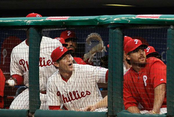 "<div class=""meta image-caption""><div class=""origin-logo origin-image none""><span>none</span></div><span class=""caption-text"">A squirrel leaps down into the Philadelphia Phillies' dugout near Chase Utley during a game against the St. Louis Cardinals, June 19, 2015, in Philadelphia. (AP Photo/ Matt Slocum)</span></div>"