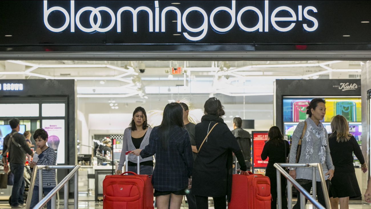 Consumers shop at the Bloomingdale's store at the Glendale Galleria shopping mall in Glendale, Calif, Friday, Nov. 28, 2014.
