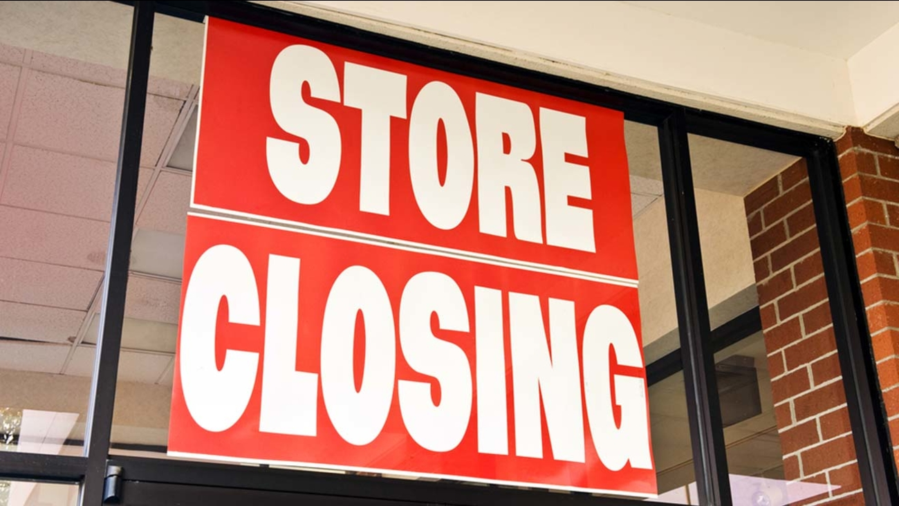 A stock image of a store closing sign.