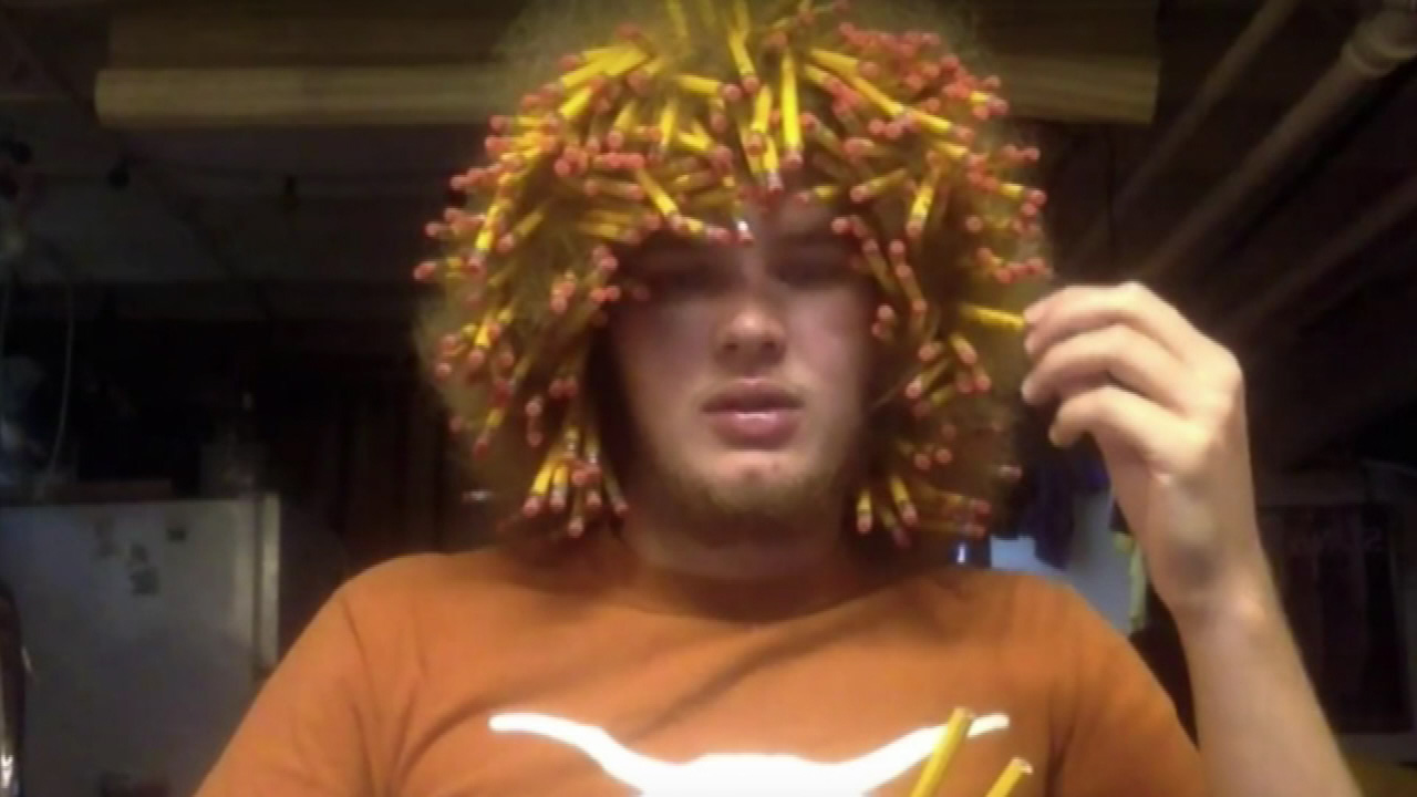 Derek Harmes is going for the record of sticking the most pencils into his hair.