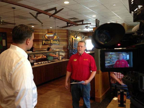 """<div class=""""meta image-caption""""><div class=""""origin-logo origin-image none""""><span>none</span></div><span class=""""caption-text"""">Tom Koch doing an interview from an Iowa restaurant (KTRK Photo)</span></div>"""