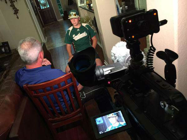"""<div class=""""meta image-caption""""><div class=""""origin-logo origin-image none""""><span>none</span></div><span class=""""caption-text"""">Kevin Quinn interviewing a former Pearland baseball player who went to the LLWS last year (KTRK Photo)</span></div>"""