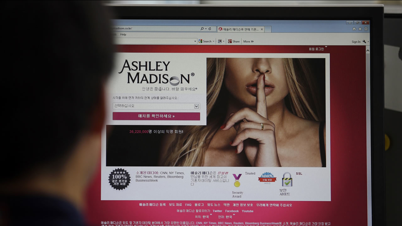 A June 10, 2015 photo from files showing Ashley Madison's Korean web site on a computer screen in Seoul, South Korea.