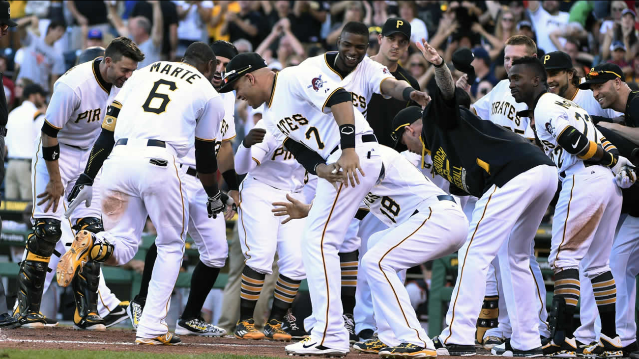 Pittsburgh Pirates' Marte (6) is greeted by his teammates after hitting a game-winning home run off of Giants' pitcher Kontos Saturday, Aug. 22, 2015, in Pittsburgh.