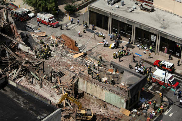 <div class='meta'><div class='origin-logo' data-origin='none'></div><span class='caption-text' data-credit=''>Rescue personnel work the scene of a building collapse in Center City Philadelphia on June 5, 2013.</span></div>
