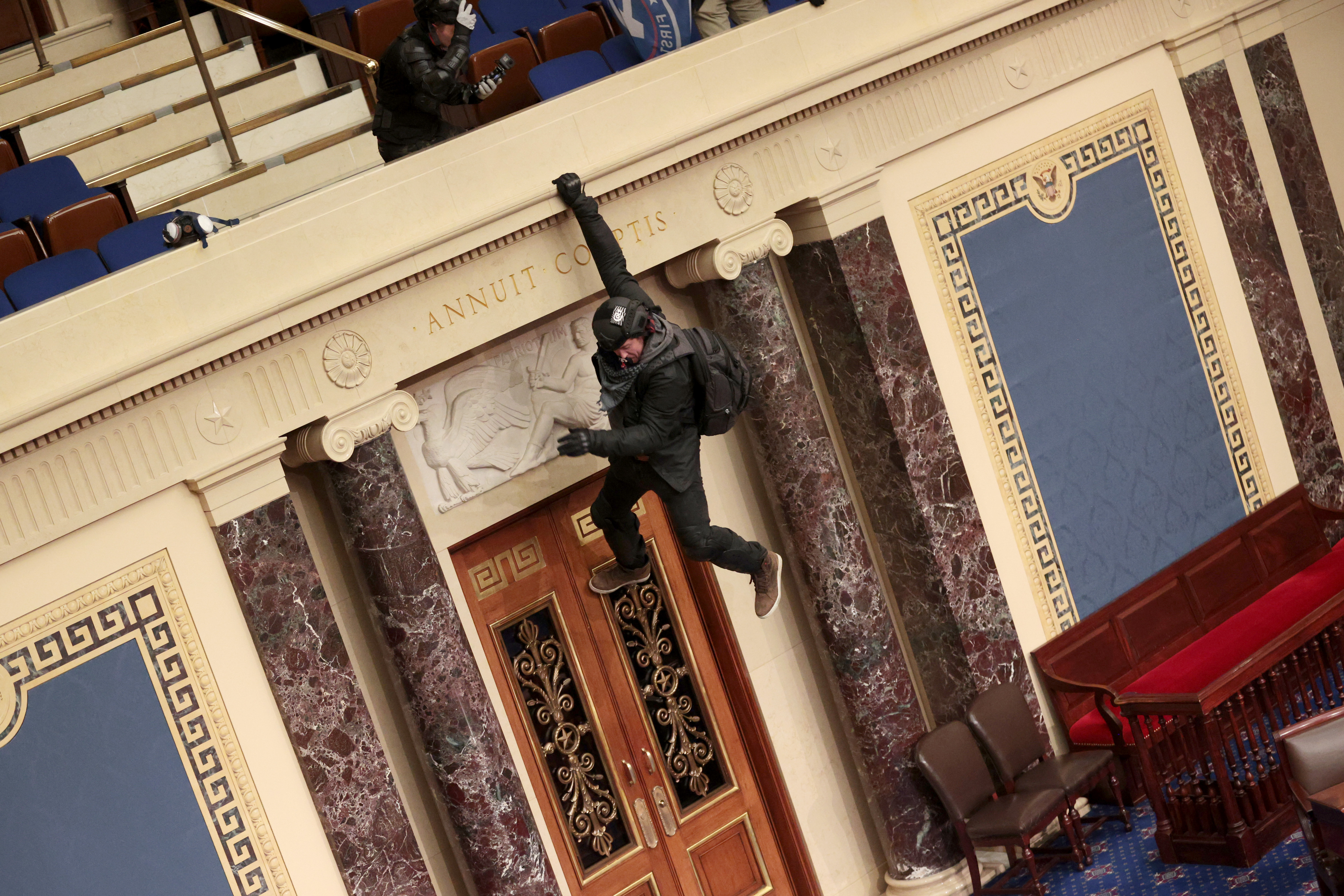 This image, taken Jan. 6, 2021, shows a man hanging during a riot at the U.S. Capitol.