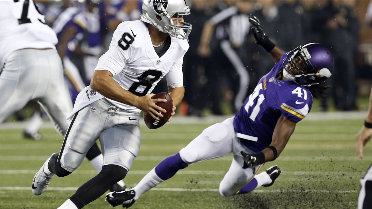 Raiders QB Cody Fajardo (8) scrambles away from Minnesota Vikings strong safety Anthony Harris (41) during a preseason NFL football game, Saturday, August 22, 2015.