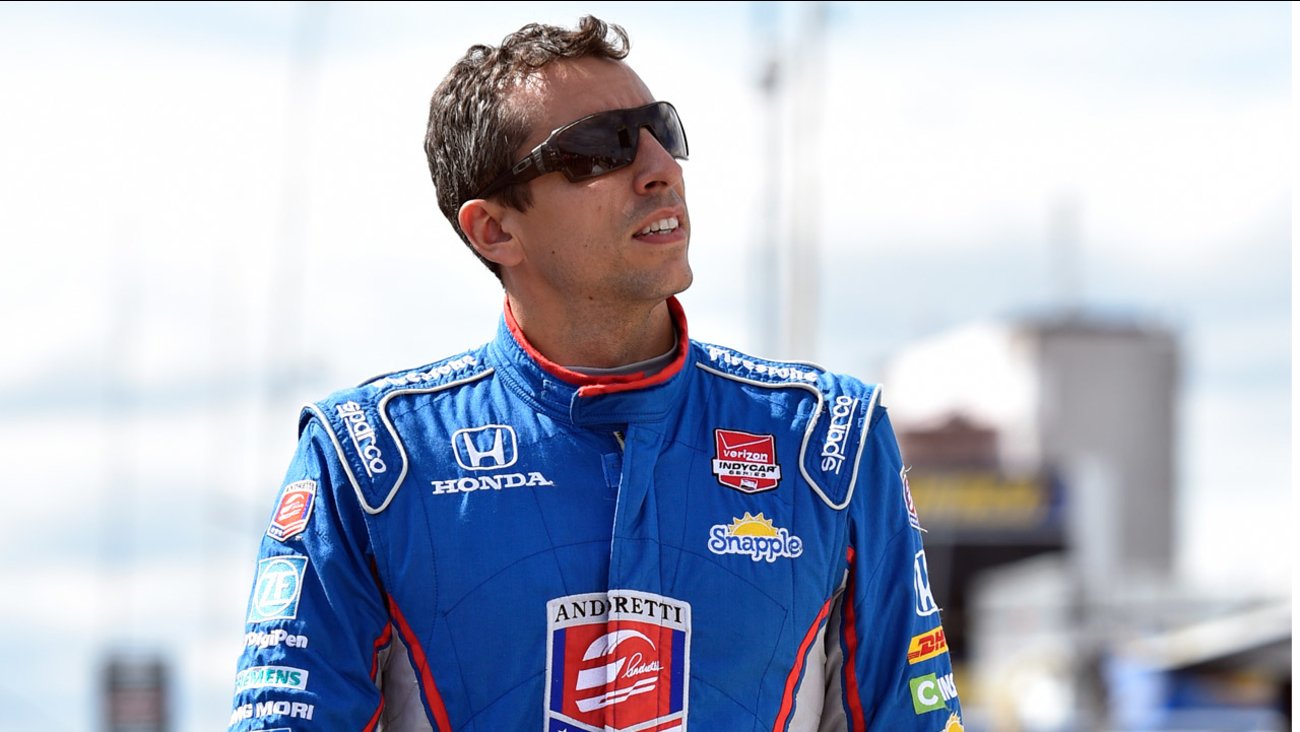 Justin Wilson, of England, walks on pit road during qualifying for Sunday's Pocono IndyCar 500 auto race, Saturday, Aug. 22, 2015, in Long Pond, Pa.
