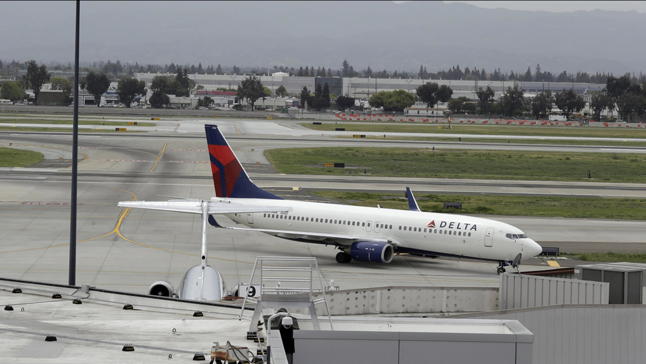 A plane taxis after landing at Mineta San Jose International Airport, Monday, April 21, 2014, in San Jose, Calif. (AP Photo/Eric Risberg)