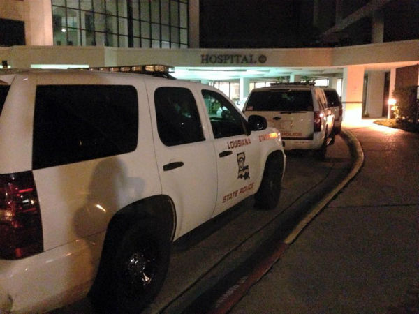 "<div class=""meta image-caption""><div class=""origin-logo origin-image none""><span>none</span></div><span class=""caption-text"">Troopers gather at Lake Charles Memorial Hospital Sunday night (KTRK/Christine Dobbyn)</span></div>"