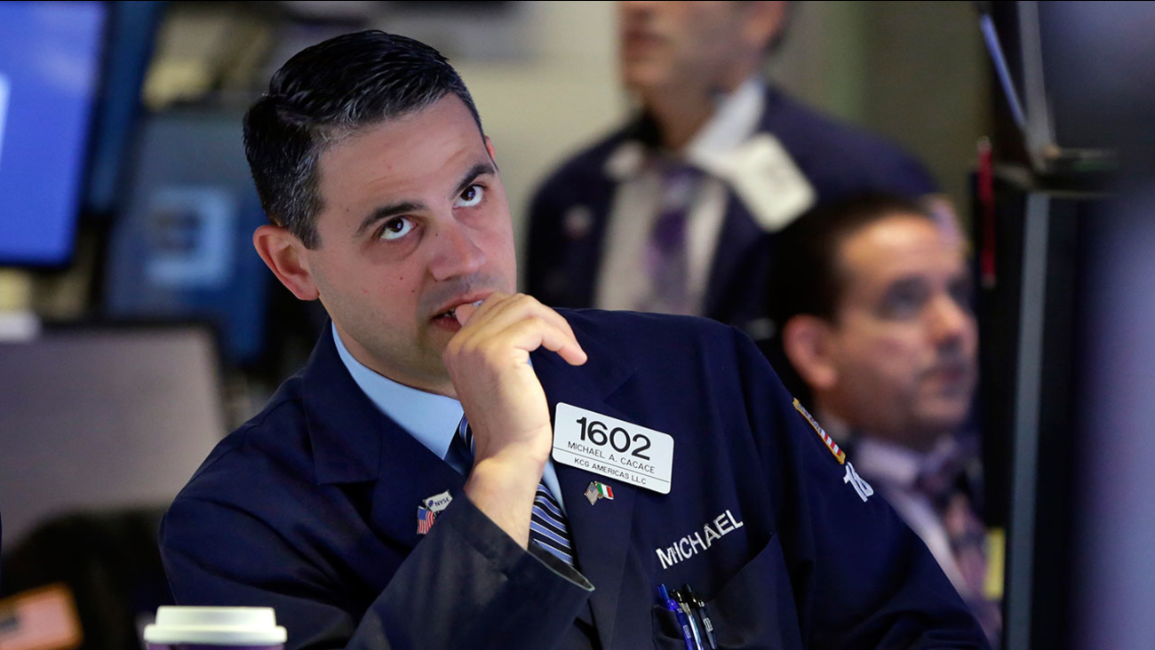 Specialist Michael Cacace works on the floor of the New York Stock Exchange, Tuesday, Aug. 25, 2015.