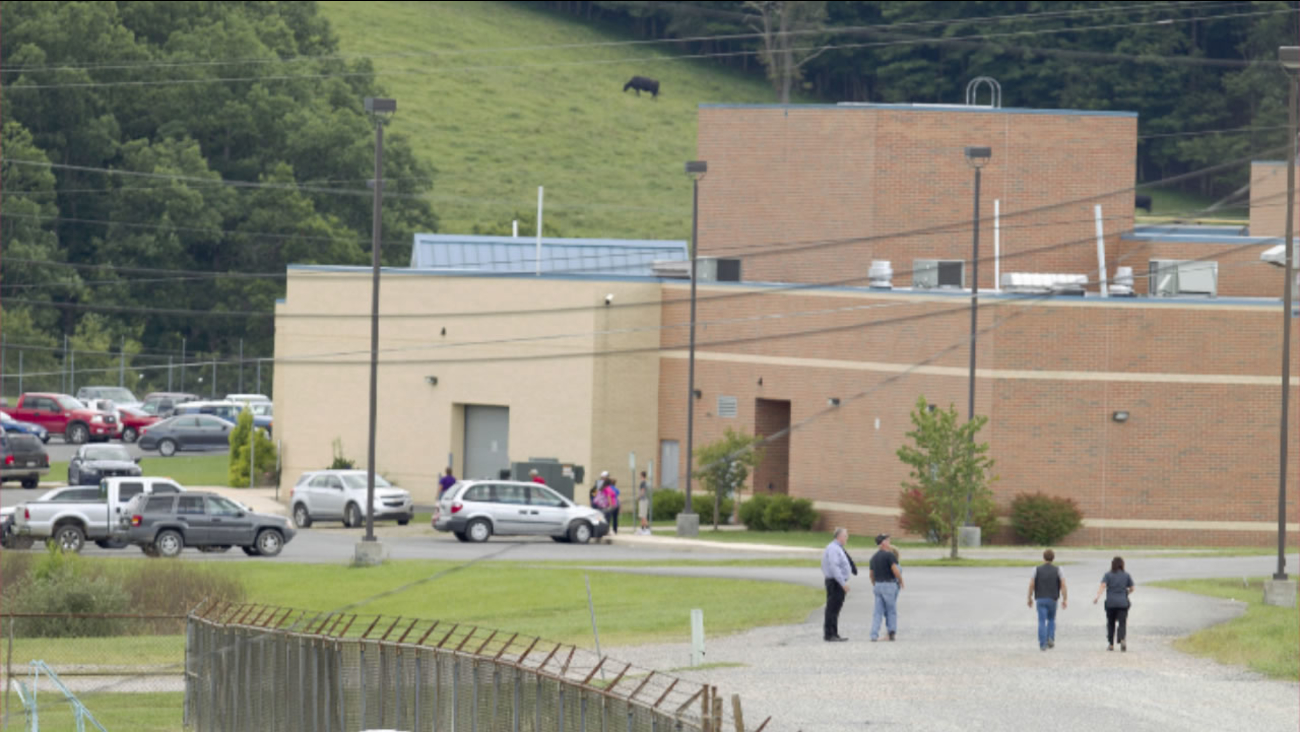 "Parents of children from Philip Barbour High School in Philippi, W.v.,walk to the school to meet up with their children that were evacuated after a ""hostage-like"" situation."