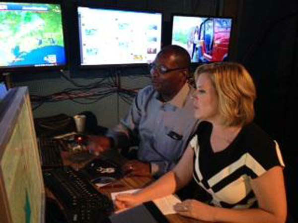 """<div class=""""meta image-caption""""><div class=""""origin-logo origin-image none""""><span>none</span></div><span class=""""caption-text"""">David Tillman and Casey Curry working together in the weather center (KTRK Photo)</span></div>"""