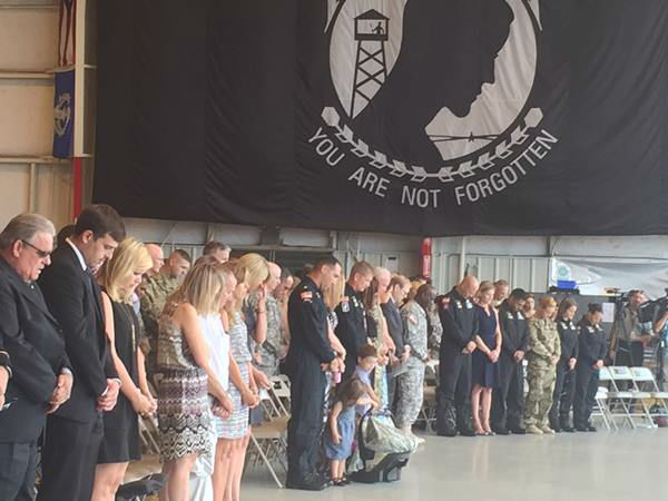 "<div class=""meta image-caption""><div class=""origin-logo origin-image none""><span>none</span></div><span class=""caption-text"">Members of the Army's elite parachute team pay their last respects to a Fort Bragg comrade who died during a Chicago air show. (WTVD Photo)</span></div>"