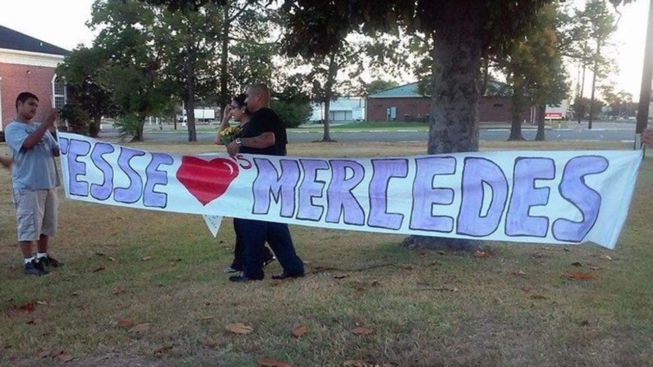 Jesse Mosquedas leads his wife, Mercedes, to the sign he made for her in an effort to regain her love and trust after he broke his marriage vows.