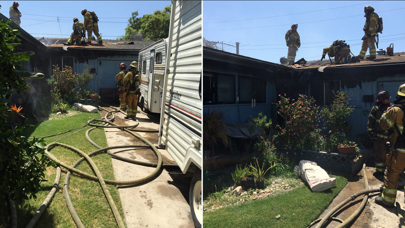 Orange County Fire Authority firefighters respond to a house fire in Buena Park on Thursday, Aug. 27, 2015.