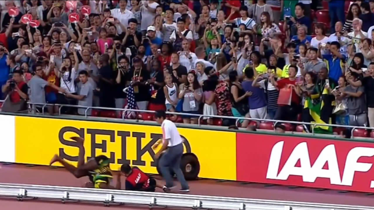 A cameraman lost control of the Segway he was on and knocked down Usain Bolt after he won the 200-meter race at the track and field World Championships in Beijing August 26, 2015.