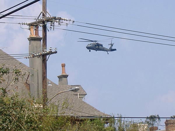 """<div class=""""meta image-caption""""><div class=""""origin-logo origin-image none""""><span>none</span></div><span class=""""caption-text"""">From the ground, a search helicopter flies over New Orleans continuing the search for victims. (WPVI Photo)</span></div>"""
