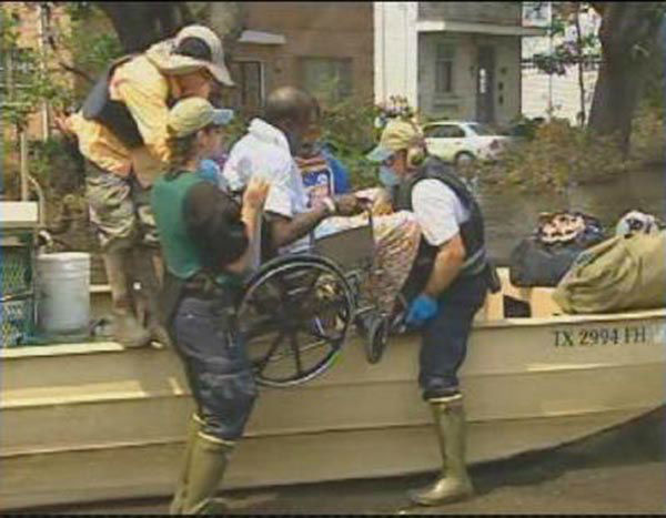 """<div class=""""meta image-caption""""><div class=""""origin-logo origin-image none""""><span>none</span></div><span class=""""caption-text"""">Days after the storm, rescuers with a boat reach a man in a wheelchair and take him to safety. (WPVI Photo)</span></div>"""