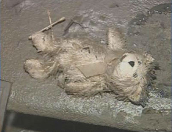 """<div class=""""meta image-caption""""><div class=""""origin-logo origin-image none""""><span>none</span></div><span class=""""caption-text"""">A mud covered teddy bear lies in the dirt outside of the Miller's home. (WPVI Photo)</span></div>"""