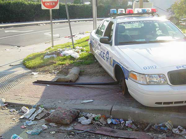 """<div class=""""meta image-caption""""><div class=""""origin-logo origin-image none""""><span>none</span></div><span class=""""caption-text"""">Outside of the convention center, an abandoned police car sits without tires. (WPVI Photo)</span></div>"""
