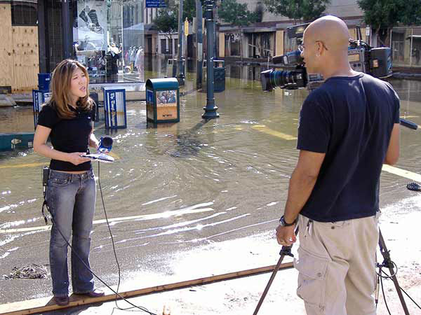 """<div class=""""meta image-caption""""><div class=""""origin-logo origin-image none""""><span>none</span></div><span class=""""caption-text"""">Nydia Han and Nick Morgan broadcast live from a flooded Canal Street in downtown New Orleans. (WPVI Photo)</span></div>"""