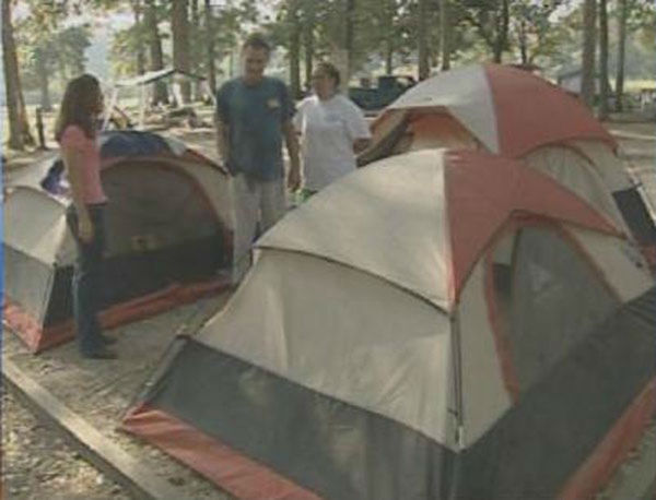 """<div class=""""meta image-caption""""><div class=""""origin-logo origin-image none""""><span>none</span></div><span class=""""caption-text"""">Robert and Tammy Miller, living in tents outside of Baton Rouge asked us to check out their home.  We found that their home had been destroyed. (WPVI Photo)</span></div>"""