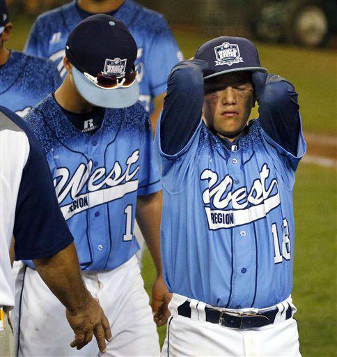 "<div class=""meta image-caption""><div class=""origin-logo origin-image none""><span>none</span></div><span class=""caption-text"">Bonita, Calif.'s Nick Maldonado (18) and Walker Lannom walk off the field after a 9-7 eighth inning loss to Pearland (AP Photo/ Gene J. Puskar)</span></div>"