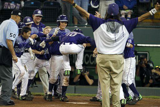 "<div class=""meta image-caption""><div class=""origin-logo origin-image none""><span>none</span></div><span class=""caption-text"">Pearland, Texas' Caleb Low (10) leaps onto home plate after hitting a two-run home run off Bonita, Calif.'s Jacob Baptista (AP Photo/ Gene J. Puskar)</span></div>"