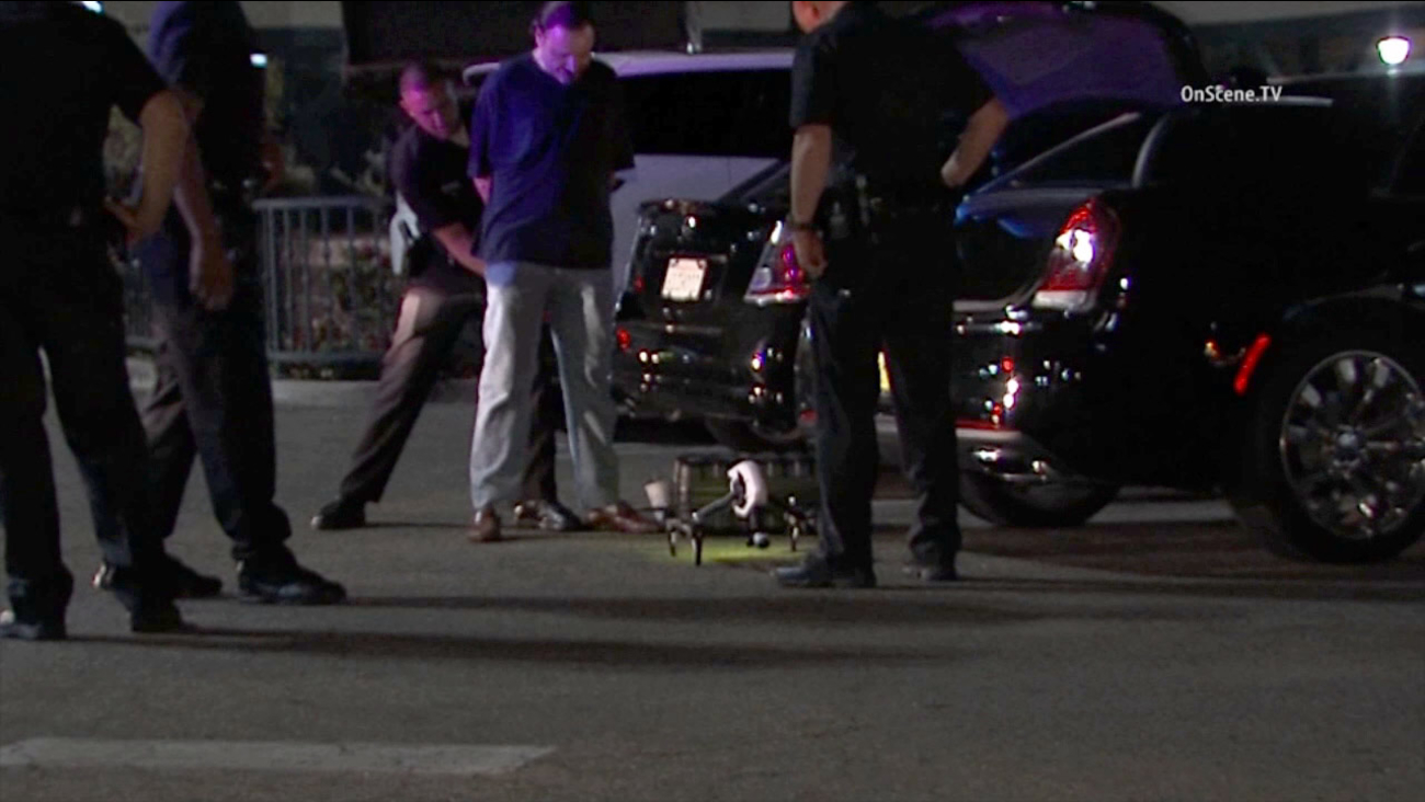 A drone operator was taken into custody in Hollywood on Thursday, Aug. 27, 2015. Police say the aircraft came very close to an LAPD helicopter during a separate suspect search.