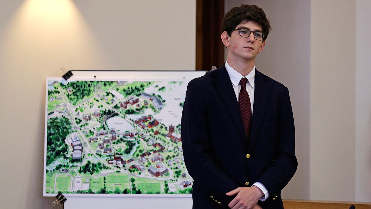 Former St. Paul's School student Owen Labrie stands next to a map of his school's campus in his trial at Merrimack Superior Court in Concord, N.H., Wednesday, Aug. 26, 2015.