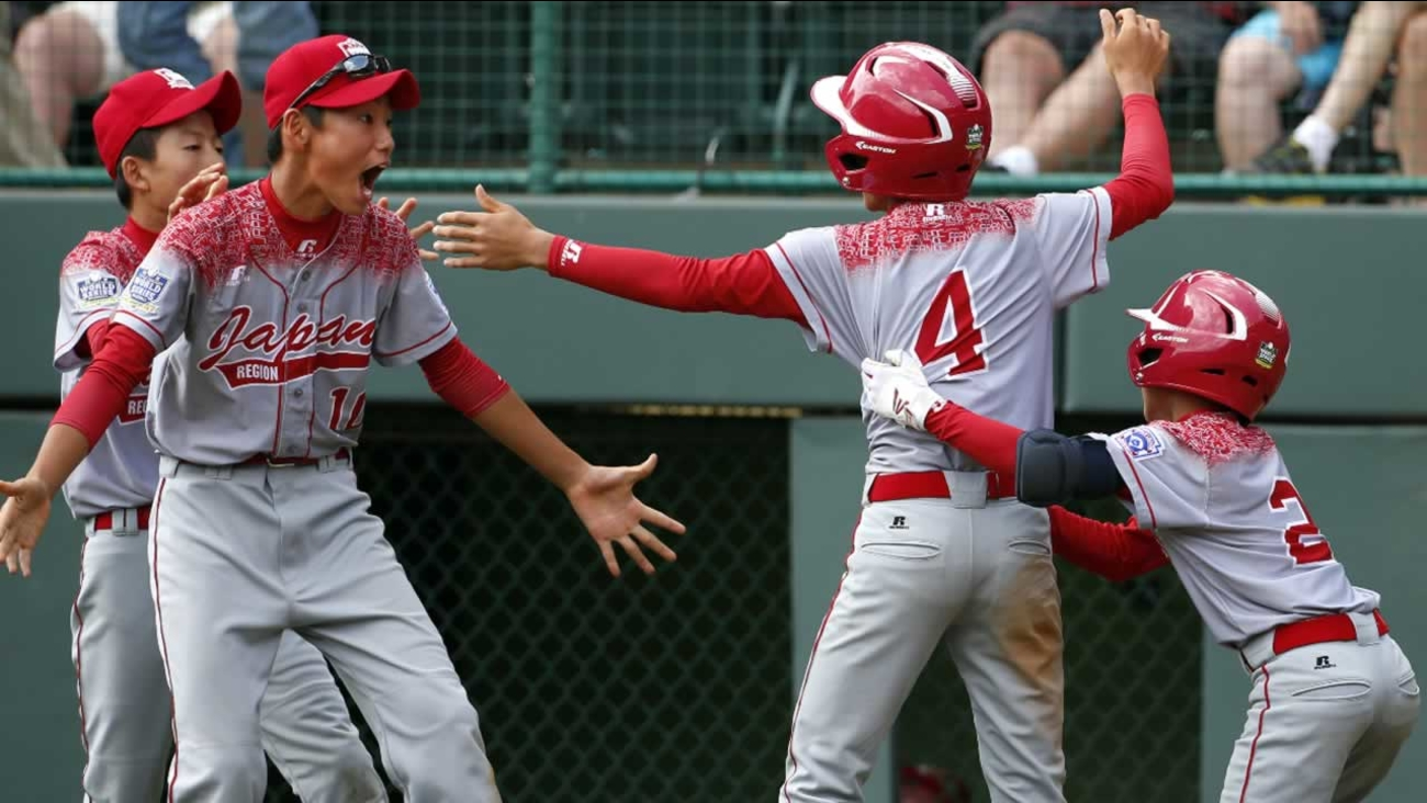 Japan's Yugo Aoki celebrates after scoring during the International championship baseball game against Mexico at the Little League World in South Williamsport, Pa. Aug. 29, 2015.