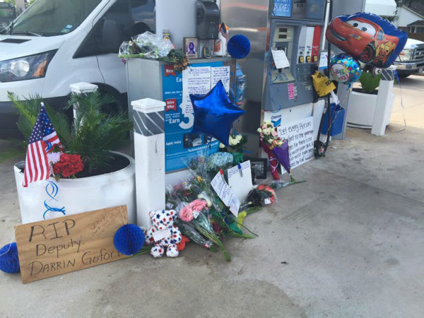 "<div class=""meta image-caption""><div class=""origin-logo origin-image none""><span>none</span></div><span class=""caption-text"">A make-shift memorial was set up at the gas station where the deputy was gunned down Friday night. (KTRK/Chauncy Glover)</span></div>"