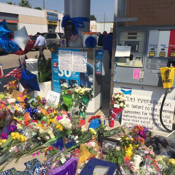"<div class=""meta image-caption""><div class=""origin-logo origin-image none""><span>none</span></div><span class=""caption-text"">A tribute for Harris County Deputy Darren Goforth is growing at the location where he was fatally shot in NW Harris County</span></div>"