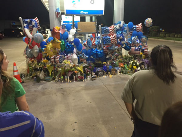 "<div class=""meta image-caption""><div class=""origin-logo origin-image none""><span>none</span></div><span class=""caption-text"">Many gathered at the gas station where the deputy was murdered for a prayer vigil.</span></div>"