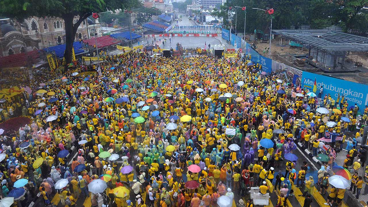 Malaysian protesters gather in the rain during a rally in Kuala Lumpur, Malaysia on Sunday, Aug. 30, 2015.
