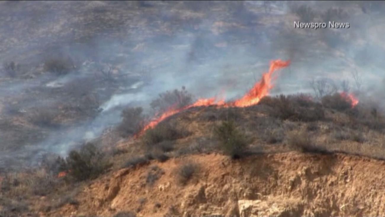 Flames burn through dry brush in San Bernardino's Waterman Canyon on Sunday, Aug. 30, 2015.