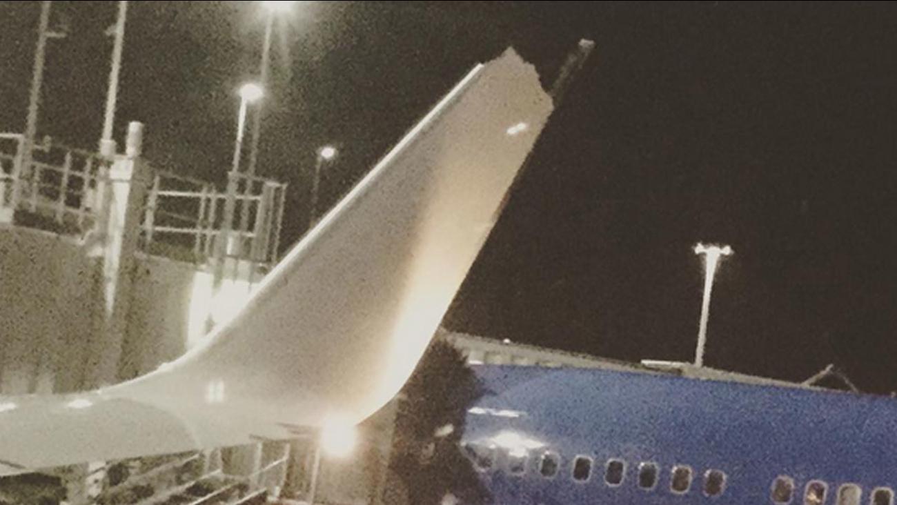 A damaged wing on a Southwest plane is shown after it clipped another plane at the Oakland International Airport on Sunday, Aug. 30, 2015.