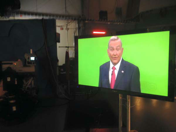 """<div class=""""meta image-caption""""><div class=""""origin-logo origin-image none""""><span>none</span></div><span class=""""caption-text"""">Dave Ward shooting a commercial in front of the green screen (KTRK Photo)</span></div>"""