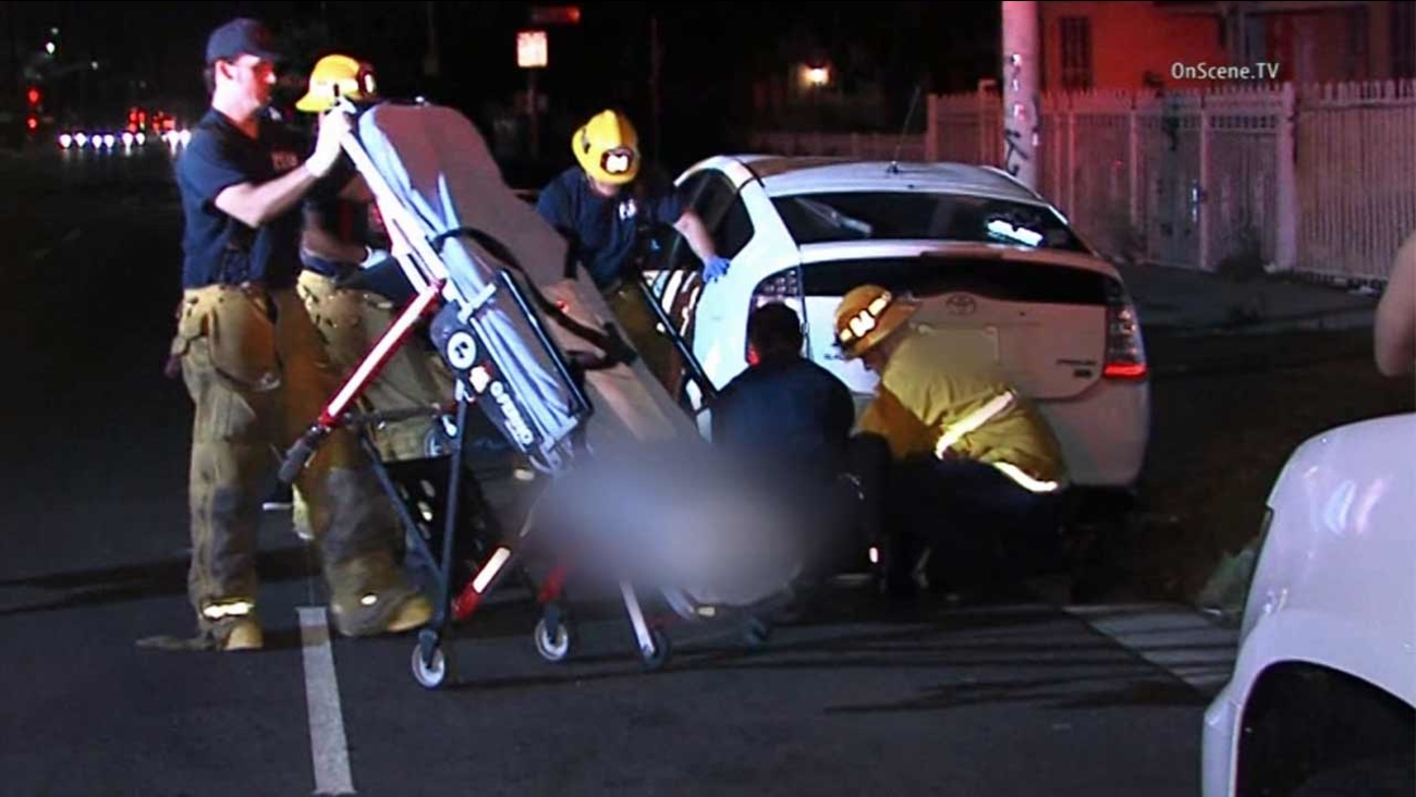 Authorities respond to a hit-and-run near the intersection of Century Boulevard and Hoover Street in South Los Angeles Sunday, Aug. 30, 2015.