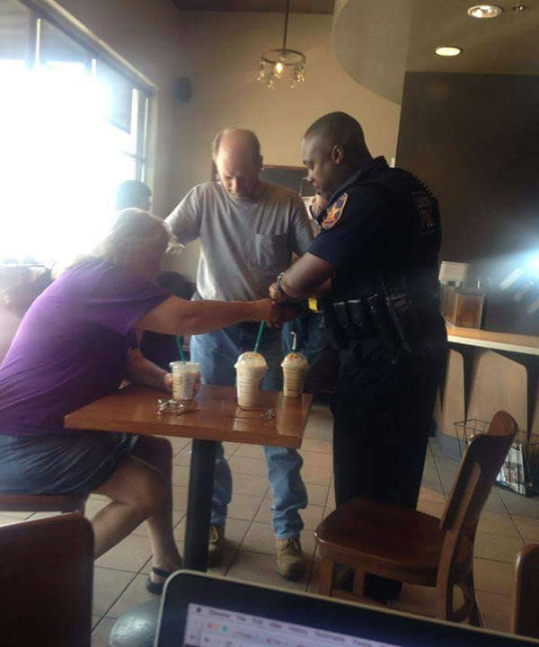 "<div class=""meta image-caption""><div class=""origin-logo origin-image none""><span>none</span></div><span class=""caption-text"">Someone captured this photo of a couple of Starbucks customers praying with a law enforcement officer. (iWitness Photo)</span></div>"