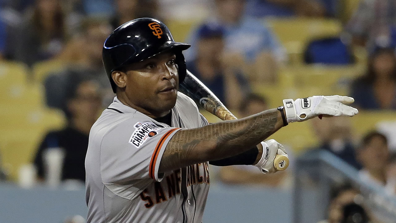 San Francisco Giants' Marlon Byrd watches his RBI-double against the Los Angeles Dodgers during the eighth inning of a baseball game in Los Angeles, Monday, Aug. 31, 2015.
