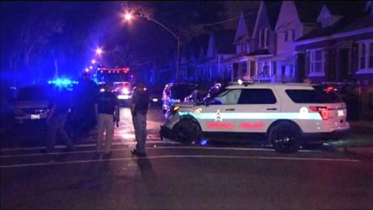 Three people, including two Chicago police officers, were injured in a crash in the city's Englewood neighborhood.