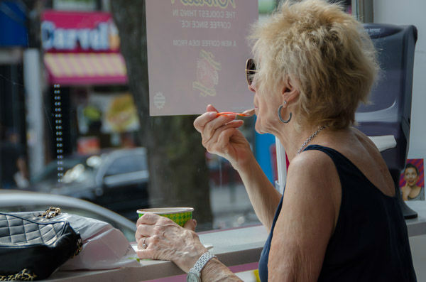 "<div class=""meta image-caption""><div class=""origin-logo origin-image none""><span>none</span></div><span class=""caption-text"">An Astoria woman eats frozen yogurt in the 'frozen yogurt district' on Sunday, Aug. 30, 2015. (WABC Photo/ Mike Waterhouse)</span></div>"