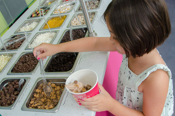"<div class=""meta image-caption""><div class=""origin-logo origin-image none""><span>none</span></div><span class=""caption-text"">Sofia B. builds her own frozen yogurt dessert in the 'frozen yogurt district on Sunday, Aug. 30, 2015. (WABC Photo/ Mike Waterhouse)</span></div>"